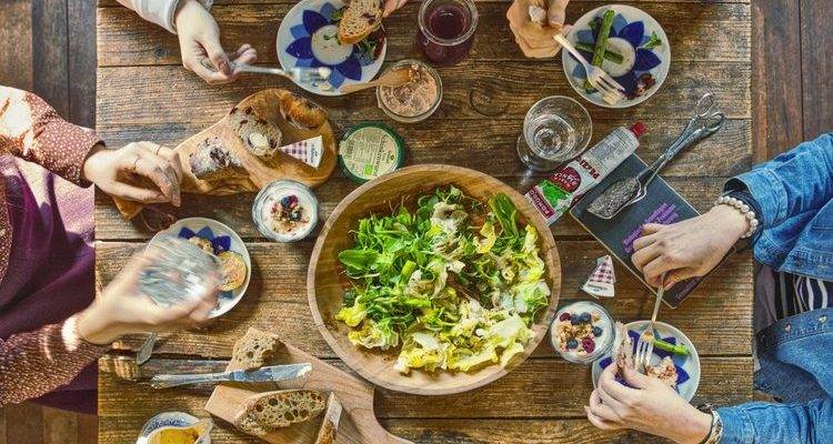 Wooden Table with Vegetarian Food and Salad